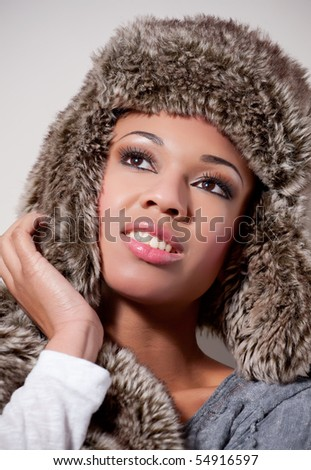 Young woman wearing a stylish winter fur hat