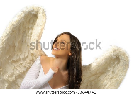 Young woman wearing angel wings with smile looking up