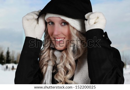 young woman wearing automn clothes, winter background - stock photo