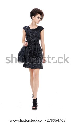 Young woman wearing black dress on white background   - stock photo