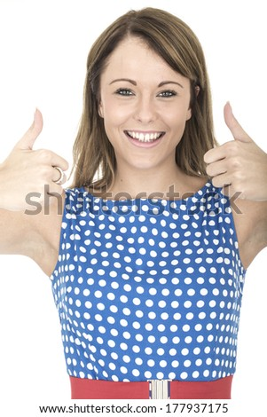 Young Woman Wearing Blue Polka Dot Dress Thumbs Up