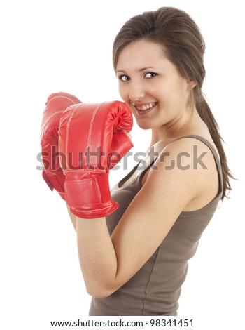 young woman wearing boxing gloves, white background - stock photo