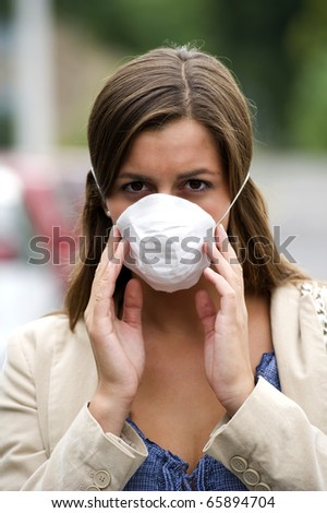 Young woman wearing breathing mask outdoors