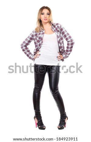 Young woman wearing checked shirt and black pants. Isolated on white - stock photo