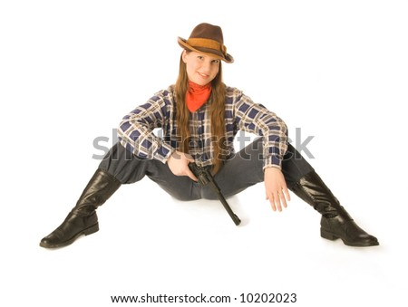 Young woman wearing cowboy clothes holding a gun