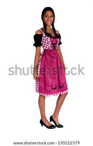 Young woman wearing dirndl standing on white background