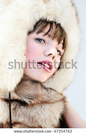 Young woman wearing fur and big hat - stock photo