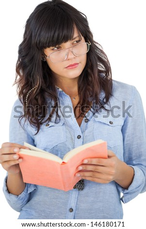 Young woman wearing glasses and thinking about her book on white background