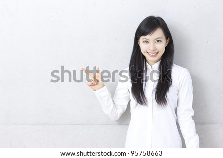 Young woman wearing glasses pointing copy space. - stock photo