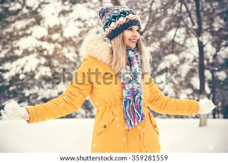 Young Woman wearing hat and scarf happy smiling playing outdoor enjoy winter snow Travel Lifestyle  - stock photo