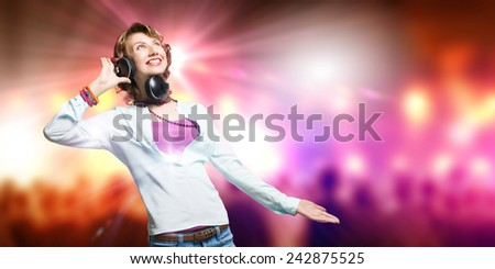 Young woman wearing headphones against bokeh background