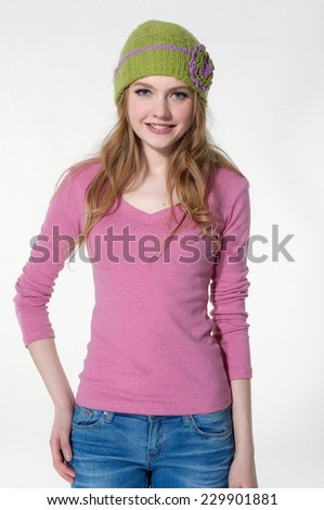 young woman wearing in hat posing in studio - stock photo
