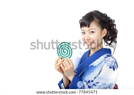 Young woman wearing Japanese kimono with mosquito coil, isolated on white background. - stock photo