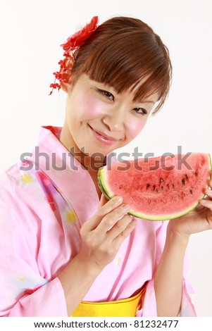 Young woman wearing Japanese kimono with watermelon
