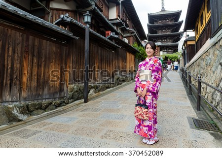 Young woman wearing kimono at yasaka pagoda - stock photo