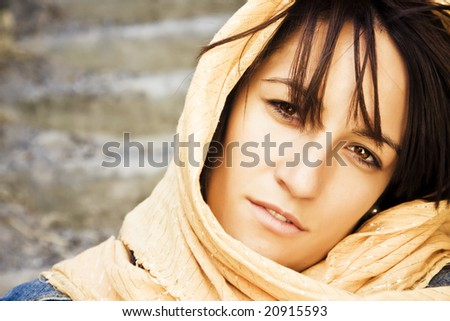 Young woman wearing muslim veil - stock photo