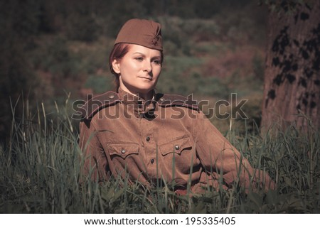 Young woman wearing Red Army form of 1943 year - stock photo