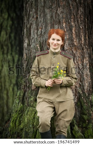 Young woman wearing Red Army form of 1943 year