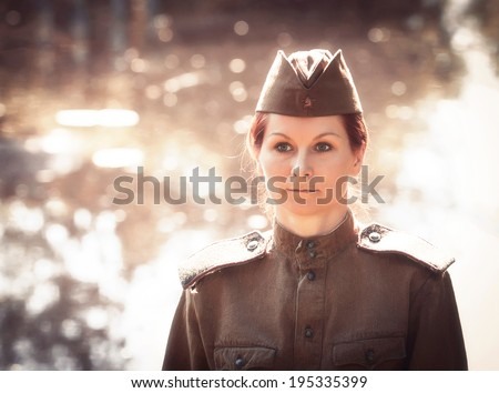 Young woman wearing Red Army form of 1943 year. Defocused effect of old photos. - stock photo