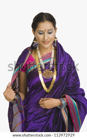 Young woman wearing sari and smiling - stock photo