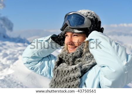 young woman wearing ski glasses outdoor in winter - stock photo