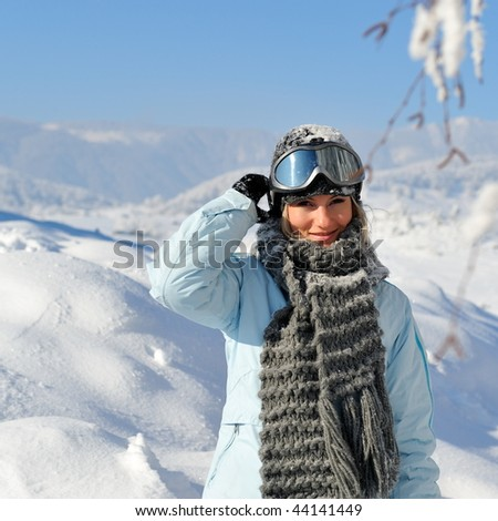 young woman wearing ski glasses outdoor in winter