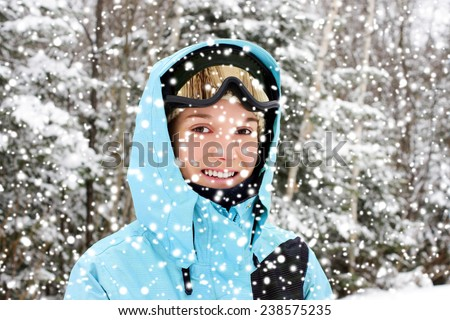 Young woman wearing sky apparels on snowy day - stock photo