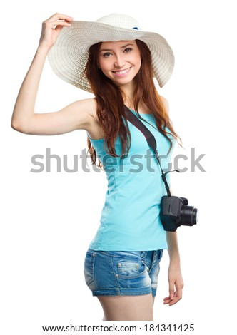 Young woman wearing summer hat is preparing for a trip, isolated over white - stock photo