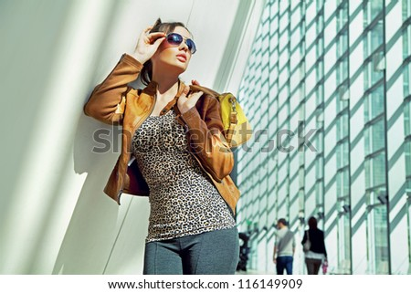 Young woman wearing sunglasses - stock photo