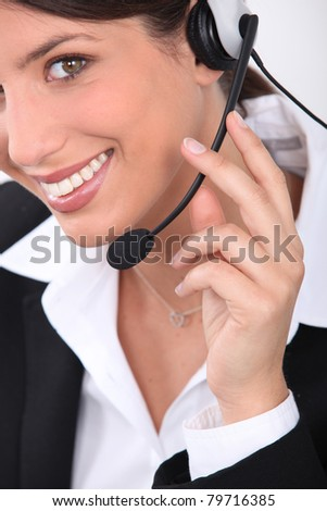 Young woman wearing telephone head set - stock photo