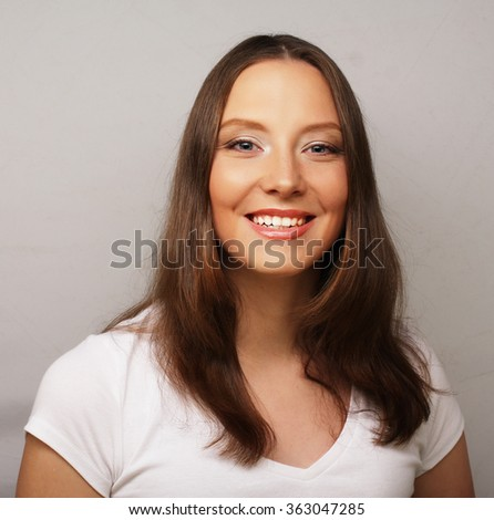 young woman wearing white t-shirt - stock photo