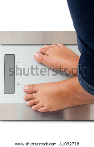 Young woman weighing herself - isolated on white - stock photo