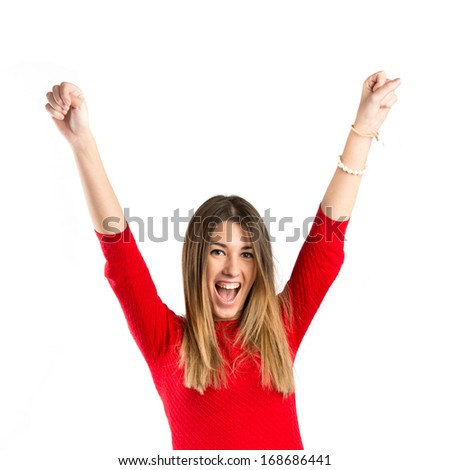 Young woman winner on white background  - stock photo