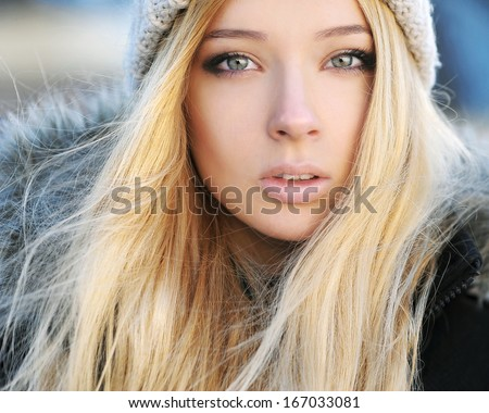 Young woman winter outdoors close-up portrait. - stock photo