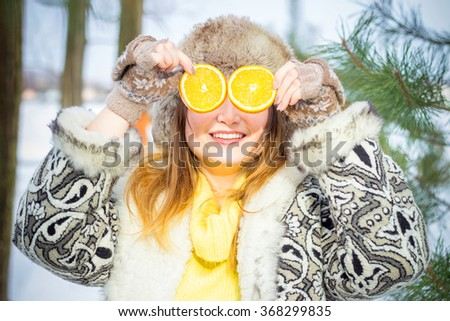 Young woman winter portrait. Shallow dof. Smiling woman with natural vitamins in winter - stock photo