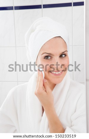 Young Woman Wiping Face With A Cotton