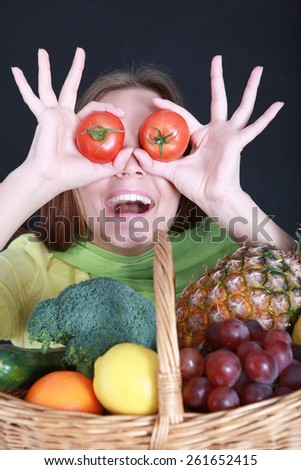 Young woman with a basket full of healthy food  - stock photo
