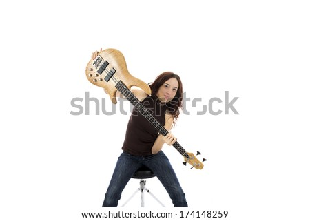 Young woman with a bass guitar (Series with the same model available)