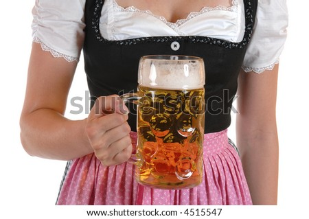 Young woman with a beer mug, dressed in a Bavarian dirndl - stock photo