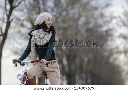 Young woman with a bicycle - stock photo
