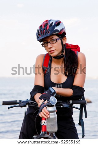 Young woman with a bike - stock photo