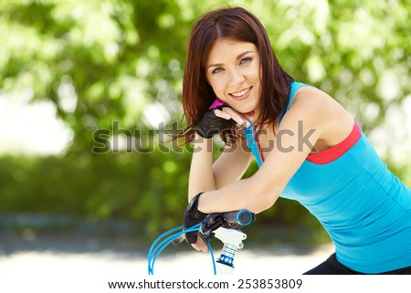 young woman with a bike in a summer park. Active people outdoors. sport lifestyle - stock photo