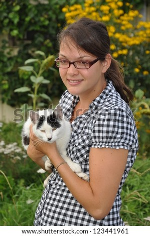 Young woman with a cat - stock photo