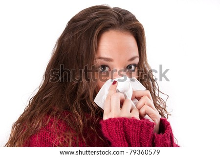 Young woman with a cold and handkerchiefs