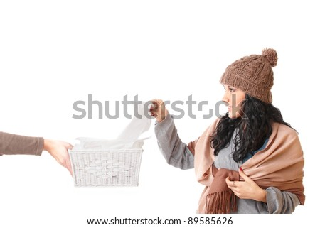Young woman with a cold reaching out for a tissue