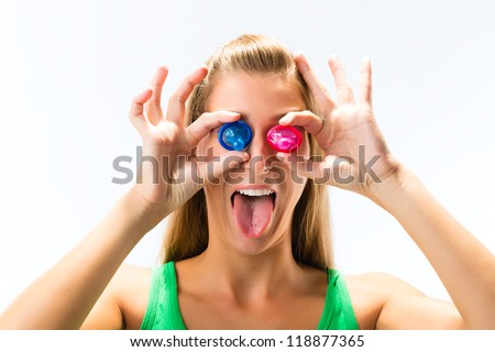 Young woman with a condom - stock photo