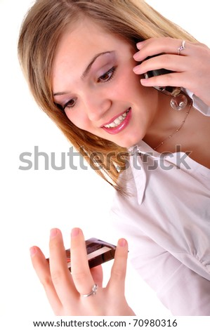 Young woman with a credit card and making a call
