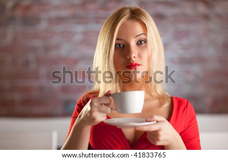 Young woman with a cup of coffee portrait. - stock photo