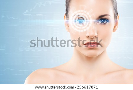 Young woman with a digital laser hologram on her eyes (ophthalmology, eye surgery and identity scanning technology concept) - stock photo