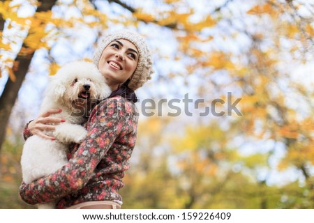 Young woman with a dog - stock photo